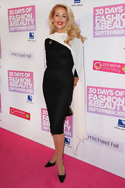 Jerry Hall was the epitome of classic elegance when she wore a black shift dress and flowing white cape on the pink carpet.
