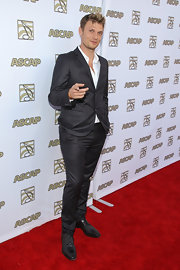 Nick Carter chose a classic two-button, notch-lapel suit for his look at the ASCAP Pop Music Awards.