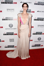 Katherine Waterston paraded plenty of skin in a nude and hot-pink Schiaparelli Couture gown with side cutouts and a navel-grazing neckline during the American Cinematheque Awards.