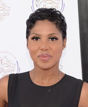 Toni Braxton attended the 'Songs in the Saddle: The Infield Music Fest' wearing her hair in a mussed-up pixie.