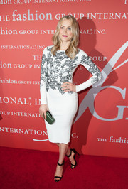 Taylor Schilling pulled her look together with a pair of black ankle-strap sandals by Kurt Geiger.