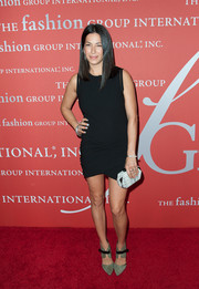Rebecca Minkoff finished off her modern ensemble with a pair of gray suede pumps featuring wide ankle straps.