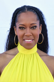 Regina King kept it classic with a pair of gold hoops.
