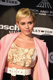 Miley Cyrus accentuated her waist with an oversized white belt by Miu Miu at the Rock and Roll Hall of Fame induction ceremony.