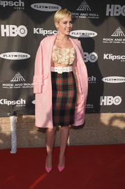 Miley Cyrus arrived for the Rock and Roll Hall of Fame induction ceremony looking retro in her pink Miu Miu coat.