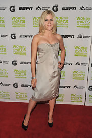 Freestyle skier Sarah Burke wore neutral colors - a strapless dress paired with black heels.