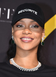 Rihanna's Chopard emerald and diamond earrings provided a glamorous contrast to her casual headwear.