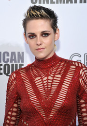 Kristen Stewart swiped on some bright red eyeshadow to match her dress.