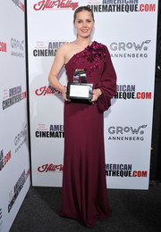 Amy Adams made an ultra-feminine choice with this floral-appliqued plum one-shoulder gown by Andrew Gn for the American Cinematheque Award.