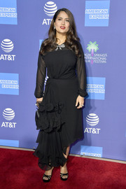 Salma Hayek complemented her frock with strappy black platforms.