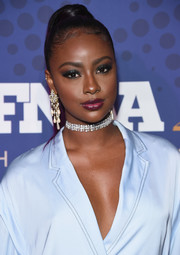 Justine Skye attended the 2017 FN Achievement Awards wearing her hair in a high ponytail.