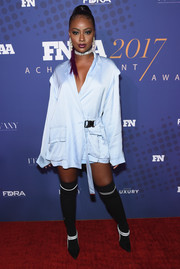 Black over-the-knee boots with white trim finished off Justine Skye's eye-catching look.