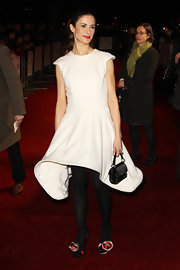 Livia looked whimsical in a white cocktail dress with a swooping hem at the London Film Critics Awards.