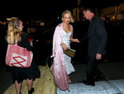 Rachel McAdams accessorized her outfit with a metallic silver clutch.
