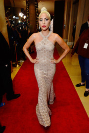 Lady Gaga was sexy-glam in a figure-hugging gold halter gown by Azzedine Alaia at the 2018 American Cinematheque Award.