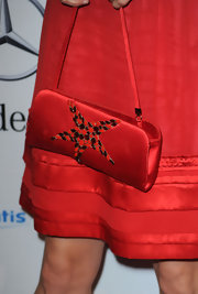 Mira Sorvino carried a star-embellished red satin purse at the Carousel of Hope gala.