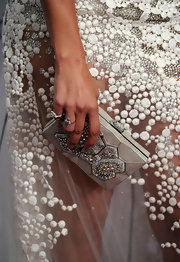 Jennifer Lopez showed off a magnificent Daniel clutch while hitting an event in Beverly Hills. The jeweled clutch was the perfect finish to her Georges Chakra gown.