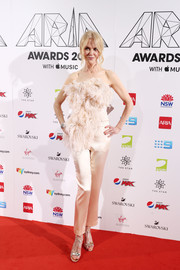 Nicole Kidman hit the 2018 ARIA Awards looking fab in a pale pink feathered top by Oscar de la Renta.
