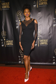 Condola Rashad looked sultry in a figure-hugging LBD with shoulder cutouts and a sheer yoke and sleeves during the Lucille Lortel Awards.