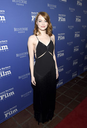Emma Stone showed her daring side at the Santa Barbara International Film Festival in a black Stella McCartney gown featuring a slashed bodice and a fringed skirt.