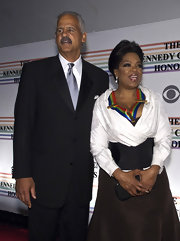 Oprah Winfrey chose a white wrap top, cinched with a corset, for her Kennedy Center Honors red carpet look.