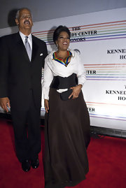 Oprah Winfrey teamed a flowing black skirt with a wrap top and a corset for the Kennedy Center Honors.