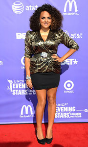 Marsha Ambrosius looked super chic in her metallic gold print blouse and mini skirt ensemble at the UNCF Evening of Stars.