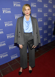 Greta Gerwig styled her suit with a pair of embellished black pumps by Aquazzura.