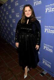 Melissa McCarthy continued the sparkle with a pair of silver pumps.