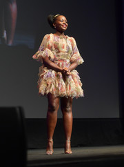 Lupita Nyong'o paired her cute frock with gold evening sandals.