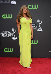 Wendy Williams showed off her elegant side in a pale yellow evening dress. Long cascading curls completed her stunning look.