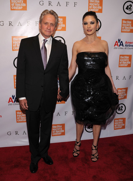 Michael Douglas and wife, Catherine Zeta-Jones look make an astonishingly fashionable couple.  Here Michael brightens up his ensemble with a lilac and silver tie.