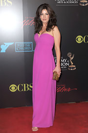 Julie Pinson showed off her toned shoulders in a pink strapless gown.