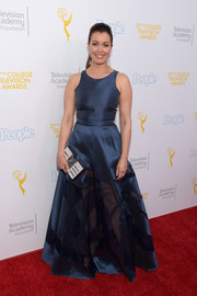 Bellamy Young paired her dress with an embellished box clutch by Emm Kuo.