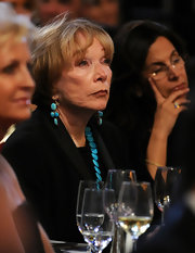 Dangling turquoise earrings stood out beautifully against the blackness of Shirley MacLaine's outfit.