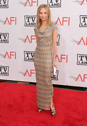 Calista Flockhart kept her red carpet look fresh and interesting with this print gown with a cowl neck.
