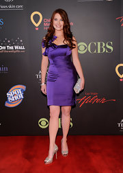 Melissa wore a lovely purple cocktail dress with sparkling heels for the Daytime Emmy Awards photo shoot.