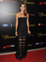 Brooke Burke-Charvet was equal parts sexy and elegant in a sheer-striped strapless gown during the Gracie Awards.