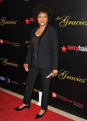 Wanda Sykes opted for a black pantsuit teamed with an embellished blouse when she attended the Gracie Awards.