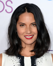 Olivia Munn sure knows how to pull off that rolled-out-of-bed sexpot hair—and, even makes it look, gasp, elegant!