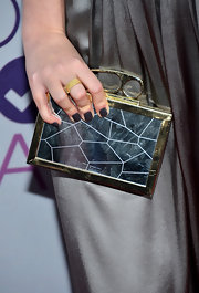 Taylor's deep-slate gel manicure at the 2013 People's Choice Awards had a thick, concrete-like texture to them.