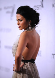 Jenna showed off the sexy open back on her evening dress with her dark brown locks styled in a messy updo.