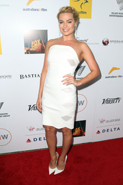 Margot Robbie kept it minimal yet stylish in a white Dion Lee strapless dress during the Australians in Film Awards.