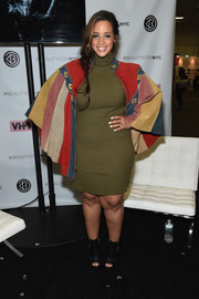 Dascha Polanco was fall-chic in a ribbed olive-green sweater dress at the 3rd Annual Beautycon Festival.