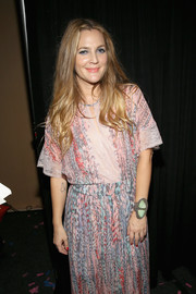Drew Barrymore attended the 3rd Annual Beautycon Festival wearing an eye-catching jade bracelet.