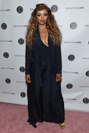 Kat Graham arrived for the 3rd Annual Beautycon Festival wearing a floor-sweeping blue duster.