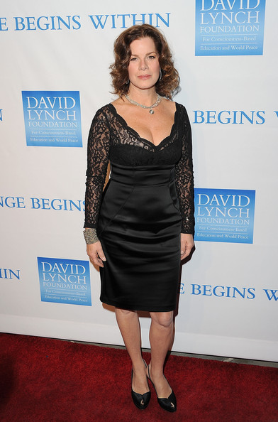 Marcia Gay Harden picked a pair of satin peep-toe slingbacks at a charity party.