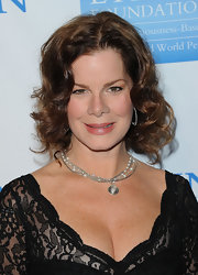 Marcia Gay Harden emphasized her decolletage with a silver chain necklace with pearl charms and a pendant.