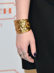 Michelle Trachtenberg paired this wide-band gold cuff with her black dress for a cool and edgy evening look.