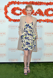 January Jones looked fun and flirty in a blue and yellow floral frock, featuring side pockets.